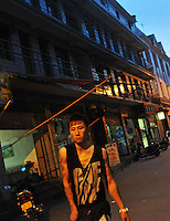 A tattooed youth in the back streets of Ruili, China. Chinese-Burmese gangs control drugs that are easily available clubs in the area and smuggled to the rest of China. The drugs come from Burma..May 2009...PHOTO BY SINOPIX