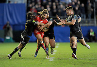 Maxime Mermoz of RC Toulon is tackled by Horacio Agulla and Ross Batty of Bath Rugby during the European Rugby Champions Cup match between Bath Rugby and RC Toulon - 23/01/2016 - The Recreation Ground, Bath Mandatory Credit: Rob Munro/Stewart Communications