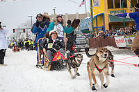 Angie Taggart and team leave the ceremonial start line at 4th Avenue and D street in downtown Anchorage during the 2013 Iditarod race. Photo by Jim R. Kohl/IditarodPhotos.com