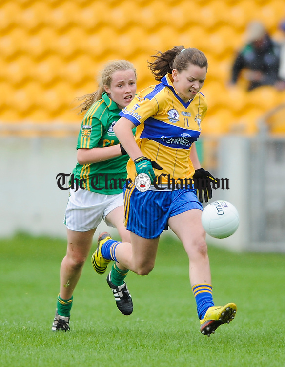Clare's Niamh O Dea races away from Donegal's Kete Kearney during their All-Ireland U-18A Minor championship final at Tullamore. Photograph by John Kelly.