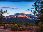 Winter Sunrise at Bear Mountain.  On the morning after a gentle winter storm, sunbeams break through residual clouds to paint the lower reaches of this prominent peak near Sedona, Arizona.<br /> <br /> Image ©2019 James D. Peterson