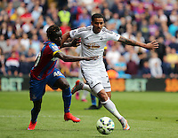 Pictured L-R: Pape Souare of Crystal Palace challenges Kyle Naughton of Swansea<br /> Re: Premier League match between Crystal Palace and Swansea City at Selhurst Park on Sunday 24 May 2015 in London, England, UK
