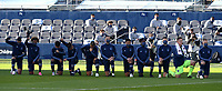KANSAS CITY, KS - NOVEMBER 22: Sporting KC starting XI take a knee during the national anthem ceremony before a game between San Jose Earthquakes and Sporting Kansas City at Children's Mercy Park on November 22, 2020 in Kansas City, Kansas.