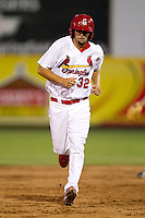 Nick Greenwood (32) of the Springfield Cardinals heads for third base during a game against the Tulsa Drillers at Hammons Field on July 19, 2011 in Springfield, Missouri. Tulsa defeated Springfield 17-11. (David Welker / Four Seam Images)