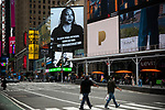 Pedestrians pass through Times Square in New York on Wednesday, April 14, 2021. Photographer: Michael Nagle