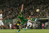 Portland, Oregon - Wednesday September 25, 2019: Jeremy Ebobisse #17 stretches for the ball during a regular season game between Portland Timbers and New England Revolution at Providence Park on September 25, 2019 in Portland, Oregon.