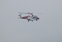 BNPS.co.uk (01202) 558833. <br /> Pic: BNPS<br /> <br /> Pictured: The Coastguard helicopter flying over Poole Harbour, Dorset. <br /> <br /> The search for a heroic teenager who is feared to have drowned after rescuing his nieces and nephews from a ferocious riptide is continuing today.<br /> <br /> Callum Osborne-Ward, 18, was swept away in front of his family moments after lifting the last of a group of children into a rescue boat.<br /> <br /> The youngsters had been swimming and playing in relatively shallow water close to Black Bridge at Rockley Point in Poole Harbour, Dorset, when they were dragged away by the fast flowing tide.