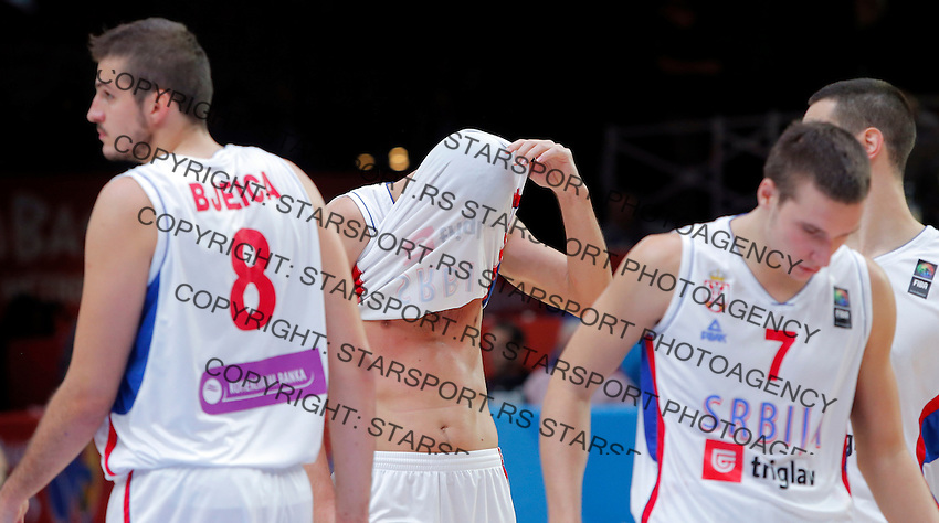 Serbia's Zoran Erceg, Bogdan Bogdanovic, Nikola Kalinic and Nemanja Bjelica reacts after European championship semi-final basketball match between Serbia and Lithuania on September 18, 2015 in Lille, France  (credit image & photo: Pedja Milosavljevic / STARSPORT)