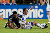 Herculez Gomez (right) asks for a call against Andre Luiz (left). The San Jose Earthquakes defeated the Kansas City Wizards in stoppage time 1-0 at Buck Shaw Stadium in Santa Clara, California on August 22, 2009.
