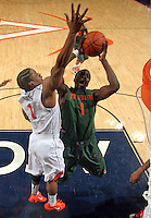 CHARLOTTESVILLE, VA- JANUARY 7: Durand Scott #1 of the Miami Hurricanes shoots next to Jontel Evans #1 of the Virginia Cavaliers during the game on January 7, 2012 at the John Paul Jones Arena in Charlottesville, Virginia. Virginia defeated Miami 52-51. (Photo by Andrew Shurtleff/Getty Images) *** Local Caption *** Jontel Evans;Durand Scott