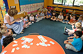 MR / Abingdon, Oxfordshire, England.Thomas Reade Primary School.Foundation Class for ages 3-5 .Teacher takes attendance as students sit in circle at beginning of school day. .(Ages 3-4 attend this class half-day, age 5 attends full-day).©Ellen B. Senisi