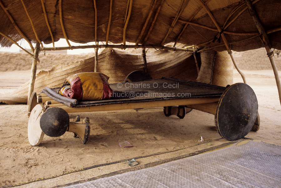 Agadez, Niger - Tuareg Bed inside Shelter, Tent.  In a few minutes all the poles, roof supports, and the axel-like end supports can be disassembled and loaded on a donkey for tyransport.