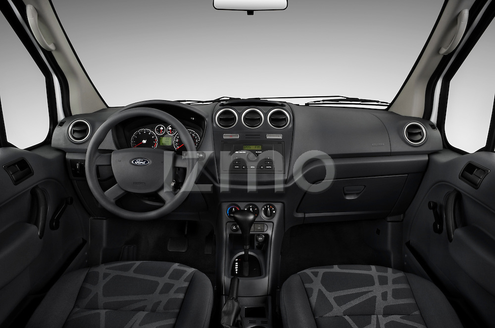 Straight dashboard view of a 2010 Ford Transit XL Wagon.