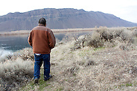 "Rex Buck Jr., leader of the Wanapum Indians, walks along the banks of the Columbia River south of the Wanapum Dam on February 3, 2011.  ""The river flows in us and we're a part of the river and we're also a part of this land.""  said Buck.  The Wanapum Indians had never moved onto a reservation but negotiated peacefully with a power company to remain on their land.  (photo credit Karen Ducey)"