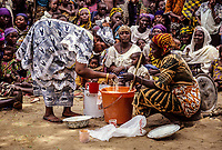 Niger, Ouna Village, West Africa.  Soap-making Demonstration.  Zarma (Djerma) Tribal Group.