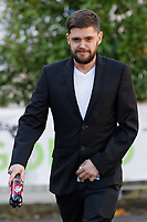 """Pictured: Daniel Ashleigh Williams arrives at Magistrates Court in Swansea, Wales, UK. <br /> Re: Daniel Ashleigh Williams, who threw a pet dog 30 feet out of a window after gaining entry into its owner's flat, has been jailed for 18 weeks by Swansea Magistrates Court, Wales, UK.<br /> Dog owner Jordanna Davies was at her sister's house when she received a text message from Daniel Ashleigh Williams on 2nd of September, who told her he was outside her house in Cilfrew, Neath. <br /> A short time later,a neighbour called her to say Williams had """"climbed into her flat"""" after breaking a window.<br /> She was told he had thrown her dog, Dobbie, out of a two-storey high window, which had a drop of 30 feet.<br /> The four-and-a-half-year-old Jack Russell cross chihuahua was discovered on the road having suffered injuries to his legs and hip."""