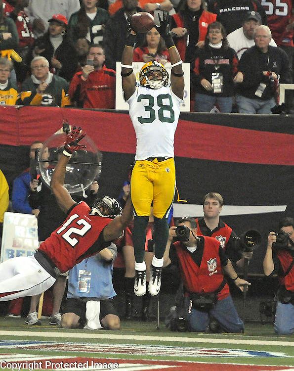 Green Bay Packers Tramon Williams (38) intercepts a Matt Ryan pass in the end zone against the Atlanta Falcons receiver Michael Jenkins during the second quarter of the Divisional round playoff game at the Georgia Dome in Atlanta, Ga., on Saturday, Jan. 15, 2011.