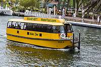 Ft. Lauderdale, Florida.  Glass-enclosed Water Taxi on the New River.