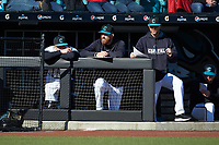 Coastal Carolina Chanticleers student assistant Matt Heidenreich (center) watches from the dugout during the game against the Illinois Fighting Illini at Springs Brooks Stadium on February 22, 2020 in Conway, South Carolina. The Fighting Illini defeated the Chanticleers 5-2. (Brian Westerholt/Four Seam Images)