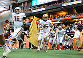 Boston College Eagles lineman Bobby Vardaro (76), kicker/punter Nate Freese (85), and lineman Harris Williams (64) coming of the tunnel before a game against the Syracuse Orange at the Carrier Dome on November 30, 2013 in Syracuse, New York.  Syracuse defeated Boston College 34-31.  (Copyright Mike Janes Photography)