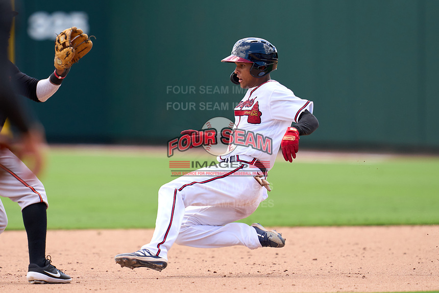 FCL Braves outfielder Jose Palma (9) slides into second base during a game against the FCL Orioles Orange on July 22, 2021 at the CoolToday Park in North Port, Florida.  (Mike Janes/Four Seam Images)
