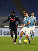 Calcio, Serie A: S.S.Lazio - Napoli, Olympic stadium, Rome, December 20, 2020. <br /> Lazio's captain Ciro Immobile (r) in action with Napoli's Tiemoue Bakayoko (r) during the Italian Serie A football match between Lazio and Napoli at the Olympic stadium, on December 20, 2020.<br /> UPDATE IMAGES PRESS/Isabella Bonotto