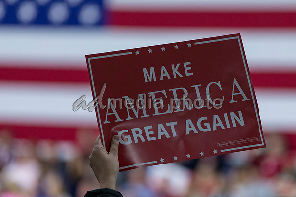 A supporter holds a campaign sign as United States President Donald J. Trump speaks during a Make America Great Again campaign rally at Atlantic Aviation in Moon Township, Pennsylvania on March 10th, 2018. Photo Credit: Alex Edelman/CNP/AdMedia