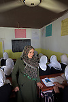 6 June 2013, Turahi Girls School, Mazar-i-Sharif, Afghanistan.  Teacher and member of the school shura council, Fowzia Faizi in her year 9 class at Turahi Girls High School in Mazar-i-Sharif.  The shura council has elders, teachers and students on it to make decisions regarding the future of the school. Much of the funding for the school including the construction of the main building was provided by  the Education Quality Improvement Program (EQUIP). The school is benefitting from EQUIP whose objective is to increase access to quality basic education, especially for girls. School grants and teacher training programs are strengthened by support from communities and private providers.  Picture by Graham Crouch/World Bank