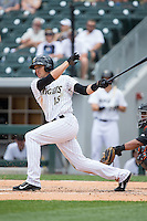Trayce Thompson (15) of the Charlotte Knights follows through on his swing against the Norfolk Tides at BB&T BallPark on June 7, 2015 in Charlotte, North Carolina.  The Tides defeated the Knights 4-1.  (Brian Westerholt/Four Seam Images)