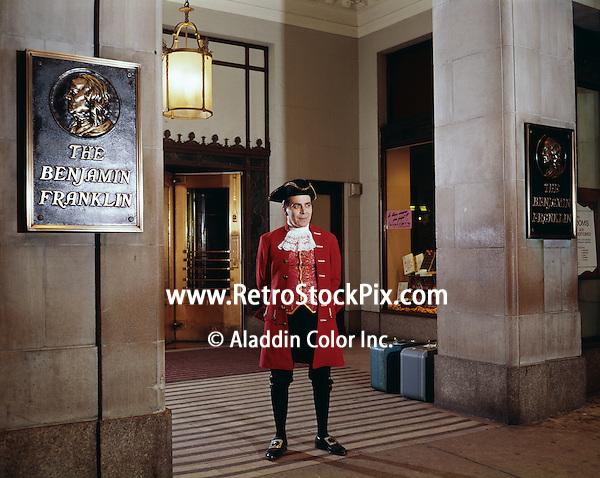 Man dressed as Ben Franklin standing outside hotel