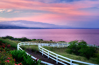 White fence,Hualalai volcano and sunrise at Kohola Ranch, Hawaii . The Big Island