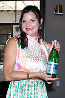LOS ANGELES - JUN 17:  Heather Tom serving S. Pellegrino 120 Year Anniversary Limited Edition Diamond Bottle at the Heather Tom Hosts the Best Actress Daytime Emmy Nominees Annual Gathering at the Chevy Chase Country Club on June 17, 2021 in Glendale, CA