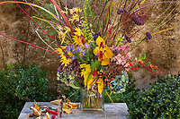 Autumn floral bouquet, with grasses, branches, seeds, foliage, leaves, flowers at Digging Fog Nursery; design Deborah Wigham.