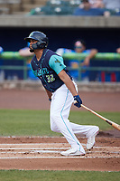 Jonathan Rodriguez (32) of the Lynchburg Hillcats follows through on his swing against the Myrtle Beach Pelicans at Bank of the James Stadium on May 22, 2021 in Lynchburg, Virginia. (Brian Westerholt/Four Seam Images)
