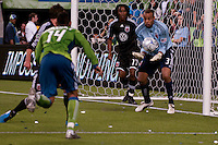 Tyrone Marshall (14) of the Seattle Sounders lines up his shot against Thabiso Khumalo (17) and Josh Wicks (37) of DC United in the match played on June 17, 2009 at Quest Field in Seattle, WA. The Sounders and United played to a 3-3 draw.