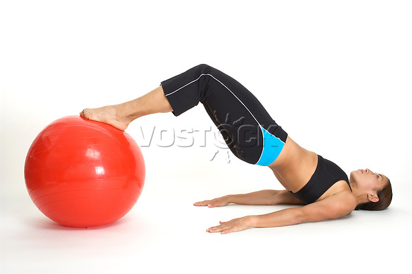 woman showing the end position of a yoga bridge with a gym ball - 01.01.2008  Model-release-yes!