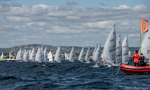 A race start of the 2021 ILCA 6 Vilamoura European Continental qualifier for the Olympic single-handed dinghy