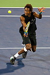 SHANGHAI, CHINA - OCTOBER 15:  Gael Monfils of France returns a ball to Ivan Ljubicic of Croatia during day five of 2009 Shanghai ATP Masters 1000 at Qi Zhong Tennis Centre on October 15, 2009 in Shanghai, China. Photo by Victor Fraile / The Power of Sport Images