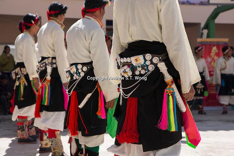 East Village, Diqing Tibetan Autonomous Prefecture, Yunnan Province, China - Tibetan men in traditional costumes perform Xianzi Dance, February 2017.