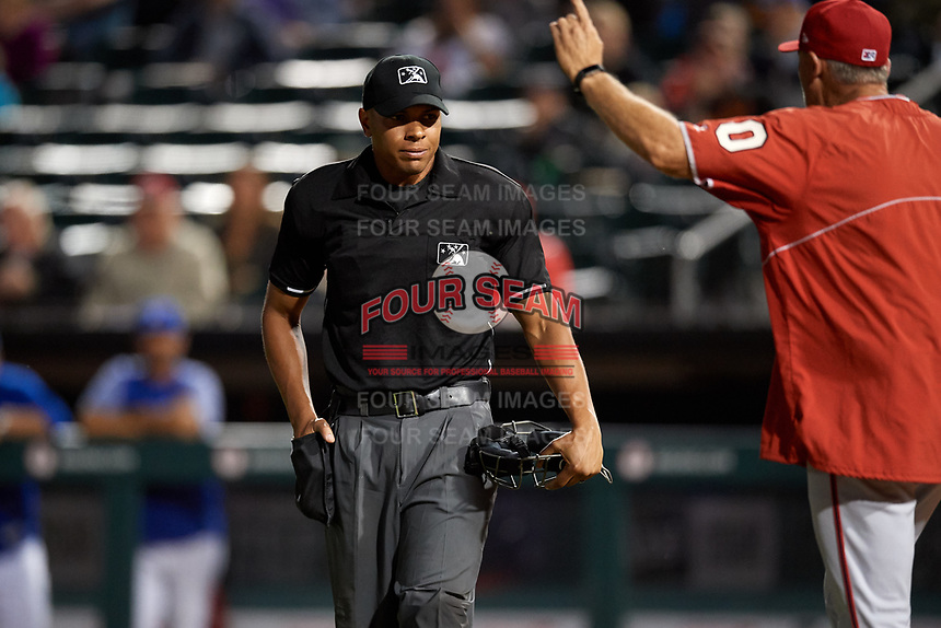 Syracuse Chiefs manager Randy Knorr (40) argues the ejection of relief pitcher Jimmy Cordero (not shown) with home plate umpire Jeremie Rehak during a game against the Buffalo Bisons on July 6, 2018 at Coca-Cola Field in Buffalo, New York.  Buffalo defeated Syracuse 6-4.  (Mike Janes/Four Seam Images)