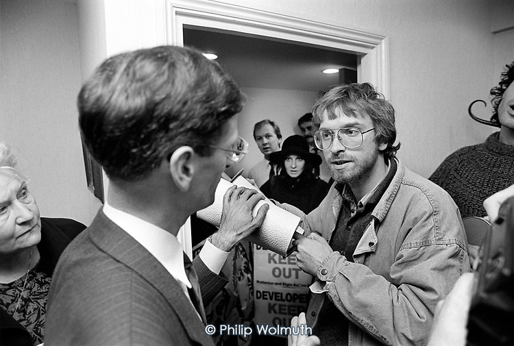 Jonathan Rosenberg and other members of the Walterton and Elgin Action Group make an unannounced visit to the offices of the Regalian Property Company to protest at its involvement with the proposed sale of the Walterton and Elgin estates by Westminster City Council, London 1987.