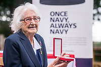 BNPS.co.uk (01202 558833)<br /> Pic: MaxWillcock/BNPS<br /> <br /> Pictured: Lorna Cockayne with the prestigious Legion d'Honneur.<br /> <br /> A brilliant Bletchley Park codebreaker who enabled the Allies to read crucial messages before Adolf Hitler received them has today been awarded the prestigious Legion d'Honneur.<br /> <br /> Lorna Cockayne, now aged 96, worked on the 'Colossus' computer which cracked the Lorenz code used by German generals to brief the Nazi leader.<br /> <br /> She fed in tape and counted letters to decipher intercepted messages for eight hours daily without a break as the giant machine never stopped.<br /> <br /> The intelligence she uncovered was particularly important in the lead-up to the D-Day landings in June 1944.