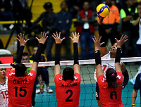 BOGOTÁ-COLOMBIA, 08-01-2020: Margarita Martínez de Colombia, clava el balón a Karla Ortiz, Diana de la Peña y Alexandra Muñoz de Perú, durante partido entre Perú y Colombia en el Preolímpico Suramericano de Voleibol, clasificatorio a los Juegos Olímpicos Tokio 2020, jugado en el Coliseo del Salitre en la ciudad de Bogotá del 7 al 9 de enero de 2020. / Margarita Martinez from Colombia, spikes the ball to Karla Ortiz, Diana de la Peña and Alexandra Muñoz during a match between Peru and Colombia, in the South American Volleyball Pre-Olympic Championship, qualifier for the Tokyo 2020 Olympic Games, played in the Colosseum El Salitre in Bogota city, from January 7 to 9, 2020. Photo: VizzorImage / Luis Ramírez / Staff.