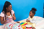 22 month old toddler girl with mother interaction playing musical instruments