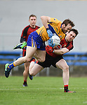 John Hayes of  Clare in action against Niall Donnelly of Down during their Division 2, Round 2 National League game at Cusack Park. Photograph by John Kelly.