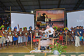 Altamira, Brazil. Encontro Xingu protest meeting about the proposed Belo Monte hydroeletric dam and other dams on the Xingu river and its tributaries. Dom Erwin Krautler passing the microphone to a Kayapo chief.