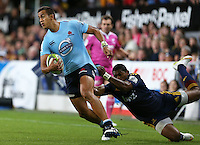 Waratahs Peter Betham, left, in the tackle of Highlanders Waisake Naholo in the Super 15 rugby match, Forsyth Barr Stadium, Dunedin, New Zealand, Saturday, March 14, 2015. Credit: SNPA/Dianne Manson