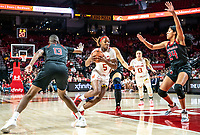 COLLEGE PARK, MD - FEBRUARY 9: Kaila Charles #5 of Maryland moves in between Mael Gilles #13 and Arella Guirantes #24 of Rutgers during a game between Rutgers and Maryland at Xfinity Center on February 9, 2020 in College Park, Maryland.