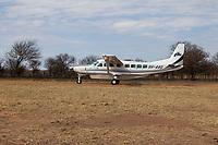 Tanzania.  Aircraft Taxiing at Lobo Airstrip, Serengeti National Park.