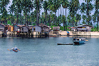 Stilt houses on the small island of Mabul near Sipidan Island, just off the coast of Borneo.  Sabah, Malaysia.